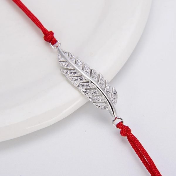 """Bracelet Red Thread """"Free Spirit"""". Focus on the silver element with cubic zirconia stones."""