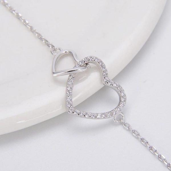 """Сребърна Гривна """"Две Сърца,Едно Цяло"""".Фокус върхъ сребърните елементи във формата на сърце"""