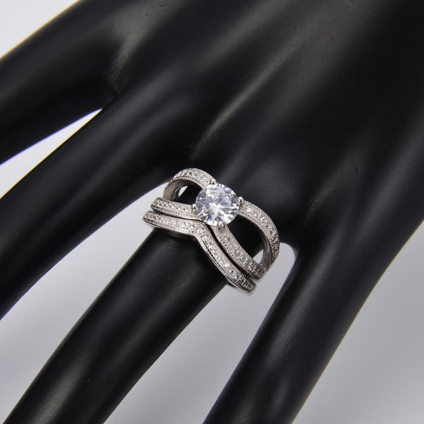 silver ring with cubic zirconia on hand