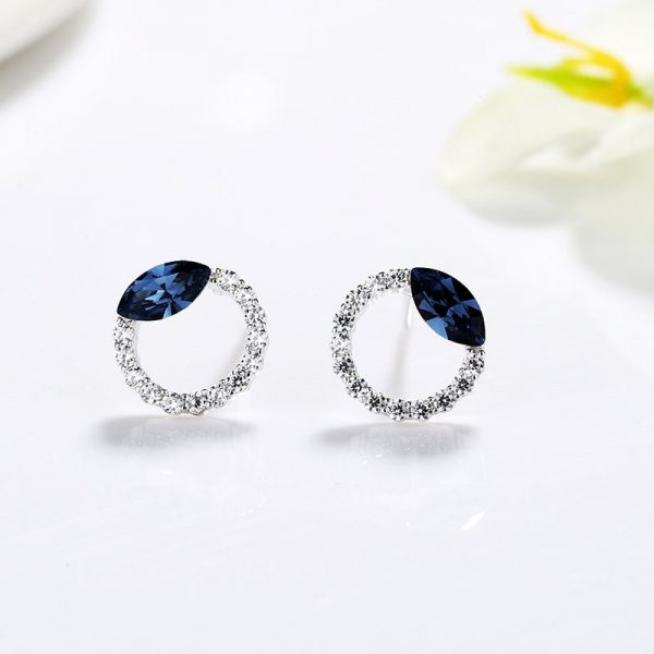 silver earrings with small stones of cubic zirconia and a large blue semiprecious stone at a price of thirty-six leva and a weight of 1 gram from silver jewelry power bulgaria