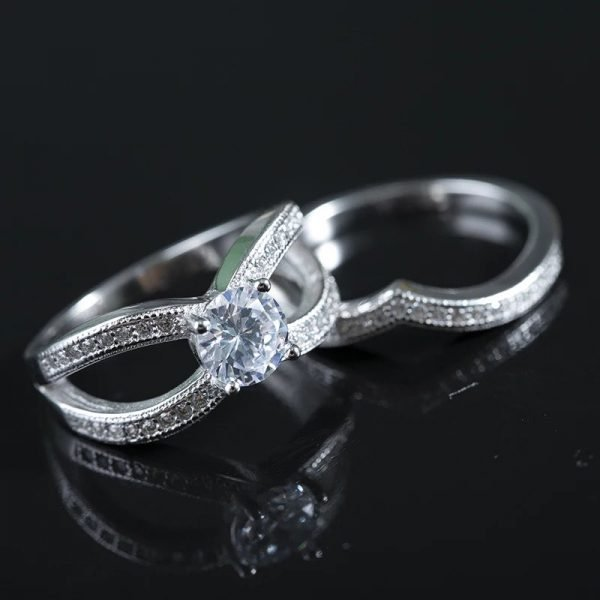 silver ring with cubic zirconia in two parts