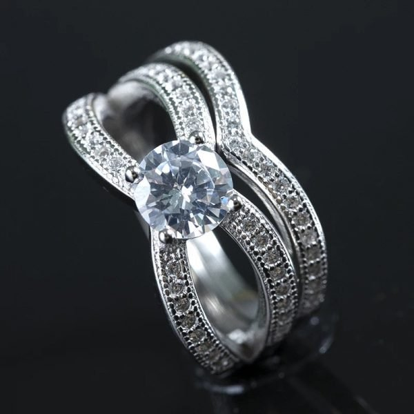 triple silver ring with cubic zirconia photographed at an angle against a black background