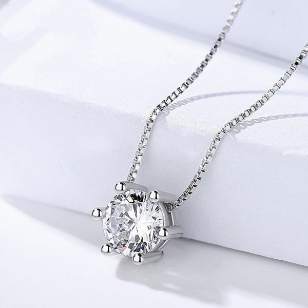 silver necklace and earrings set in round shape with large cubic zirconia stones only the necklace photographed centrally
