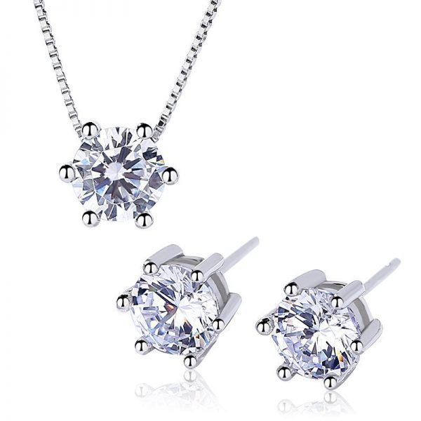 silver set necklace and earrings in round shape with large cubic zirconia stones photo on white background central