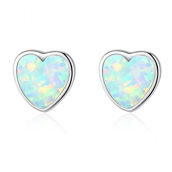 silver screw earrings in the shape of hearts with light synthetic opal photographed in detail on a white background