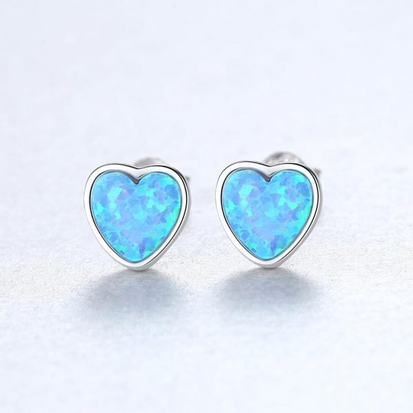 silver screw earrings in the shape of hearts with dark blue synthetic opal