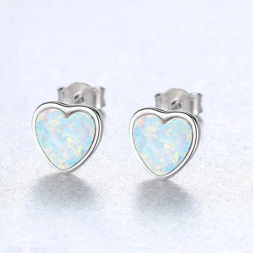 silver screw earrings in the shape of hearts with light synthetic opal