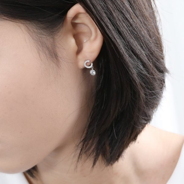 silver and cubic zirconia earrings on a woman's ear from silversmith jewellery