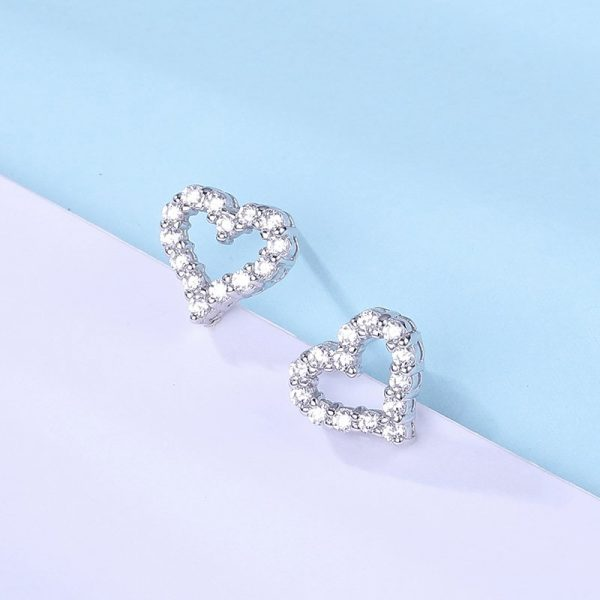 silver earrings in the shape of a heart and cubic zirconia stones