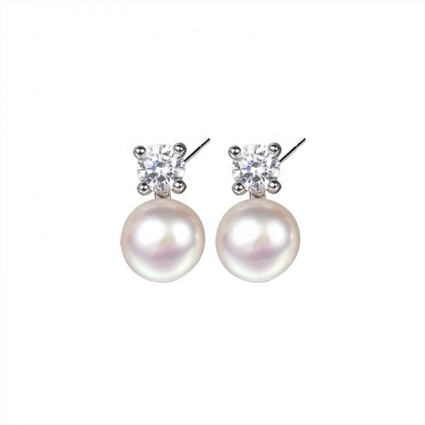 silver earrings with cubic zirconia and pearl on white background