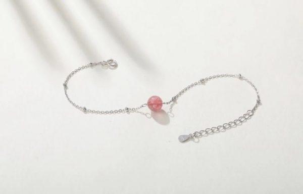 сребърна гривна с розов кристал разперена