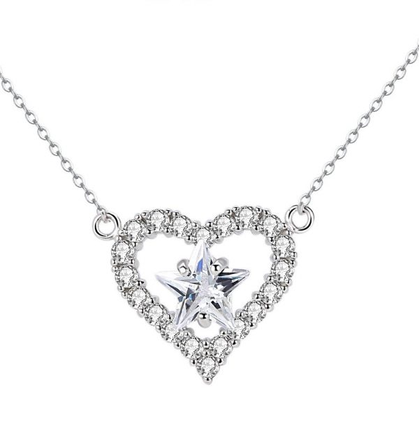 silver necklace in the shape of a heart with a cubic zirconia star in the middle of the heart on a white background