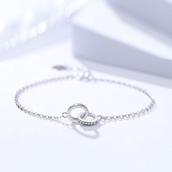 silver bracelet with cubic zirconia two halves one piece