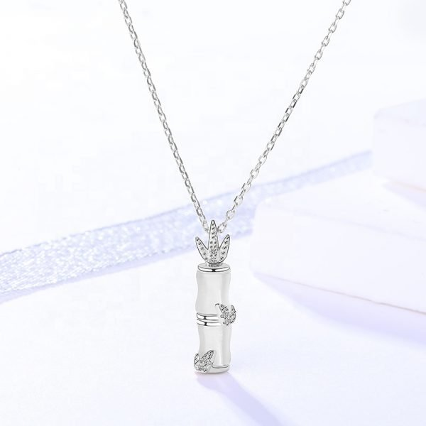 silver necklace with opal and cubic zirconia and bird charm