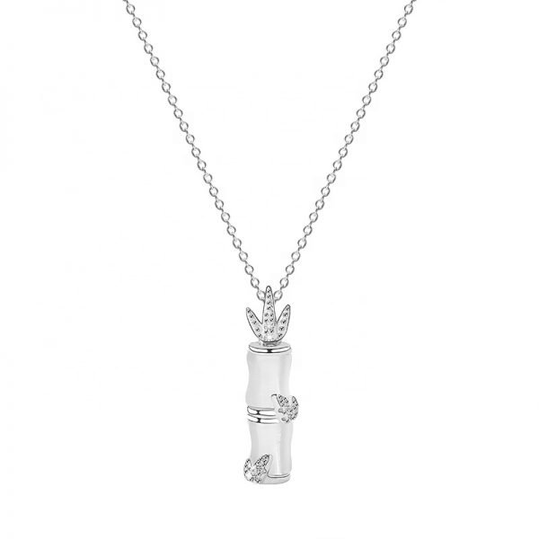 silver necklace with opal and cubic zirconia talisman in the shape of a bamboo stick and a bird