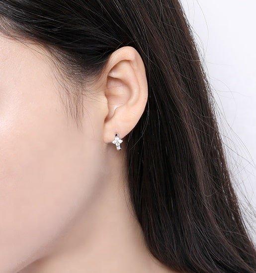 silver flower earrings photographed on woman model