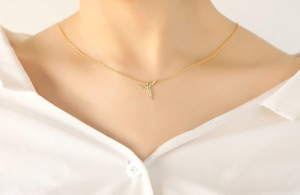 short silver necklace with gold plated angel wings