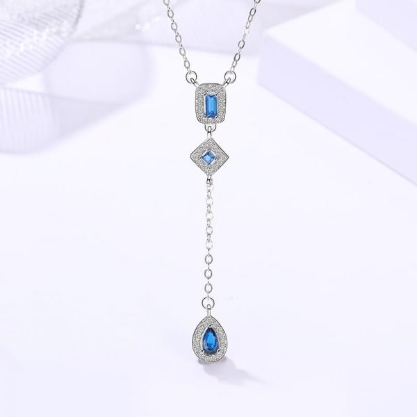 hanging silver necklace in the shape of a tear blue stone