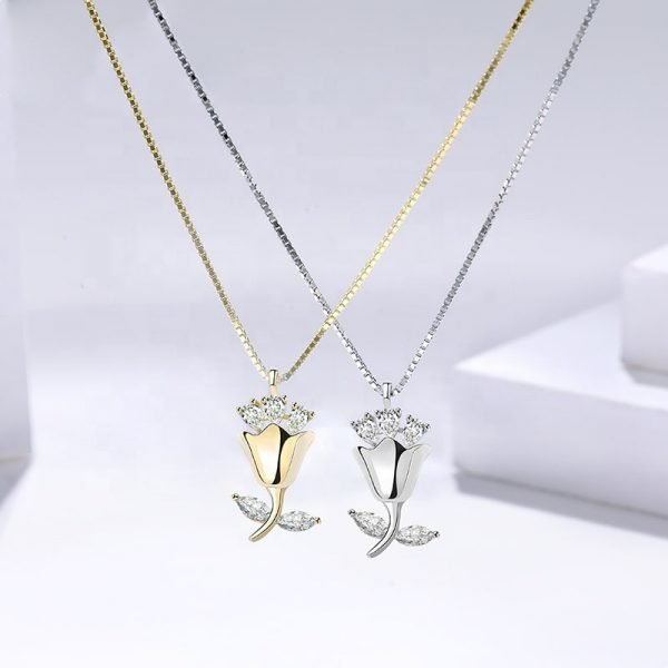 two silver necklaces one gold plated with 18 carat gold