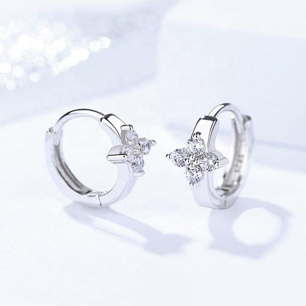 silver earrings rings in the shape of a flower