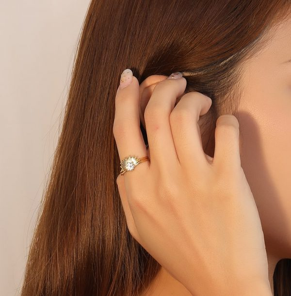 gold plated silver ring strength of female hand