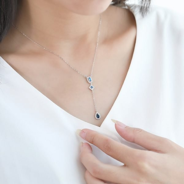 hanging silver teardrop necklace photographed on female model