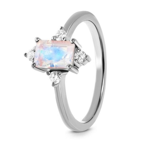 silver ring with moonstone photographed at an angle