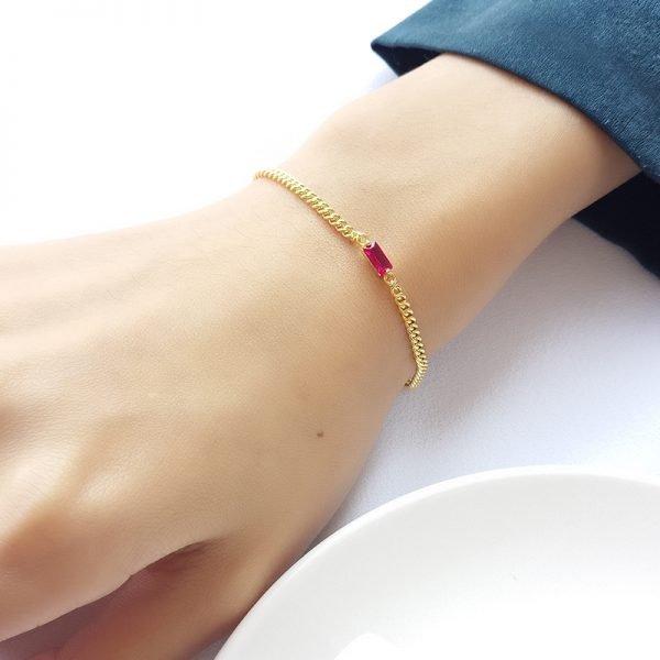 silver bracelet golden wool on female hand