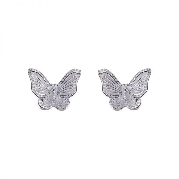 silver earrings in the shape of a butterfly photographed centrally from a close-up on a white background