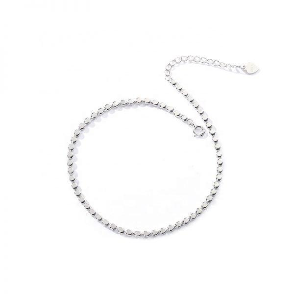 silver foot bracelet subtlety bead on white background