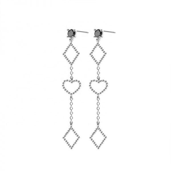 Frontal and detailed photo of dangling silver earrings with two diamonds at the top and bottom and a heart in the middle on a white background