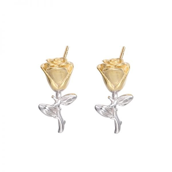 silver earrings in the shape of an eternal rose with 18 carat gold plating photographed close up against a white background