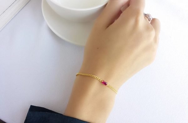 gold plated silver bracelet with red zirconium stone