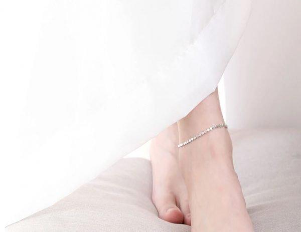 silver ankle bracelet subtlety on female foot