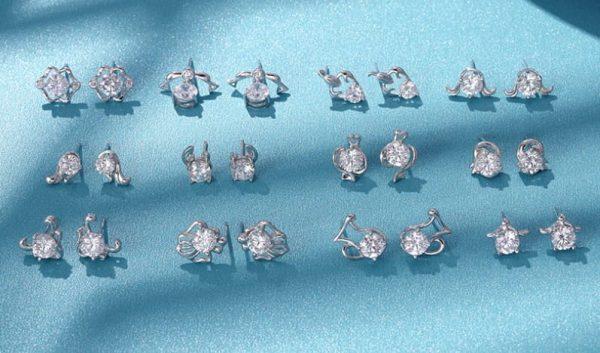 колекция от сребърни обеци и кубичен цирконий със зодиакален мотив