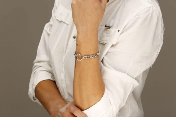 Ladies model with white shirt and solid silver dignity bracelet