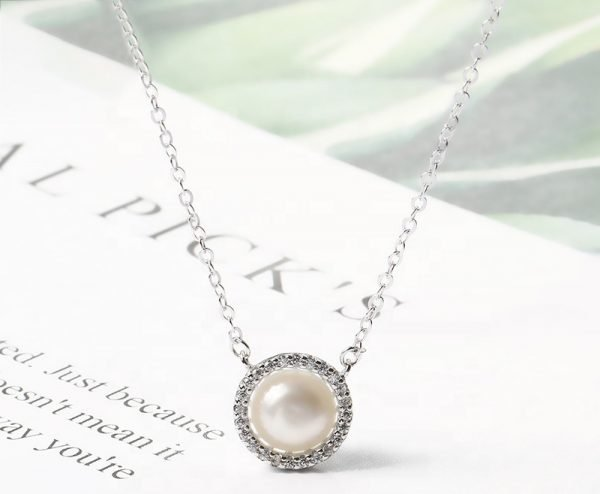 silver necklace with massive pearl photographed frontally