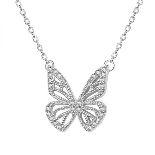 детайлнафронтална снимка на сребърно колие с медальон пеперуда обсипан с малки кристали с фокус върху медальона