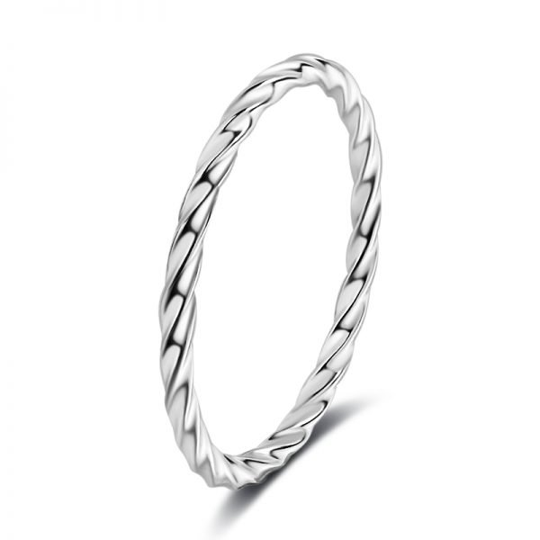 detailed photo of a clean silver ring with slight curves on a white background