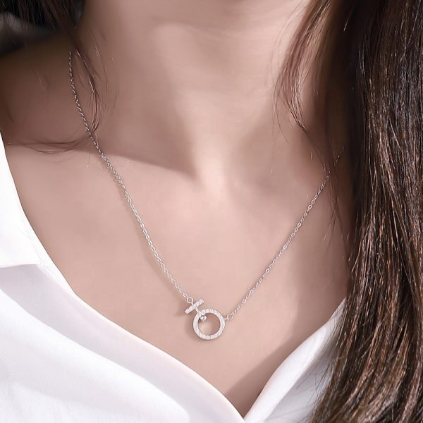 female model with silver necklace of classic braid and pendant with cubic zirconia