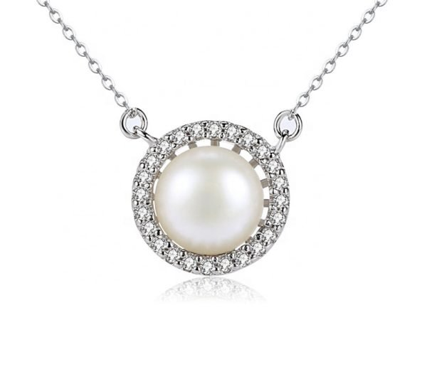 detailed frontal photo of silver pendant with small crystals and massive pearl