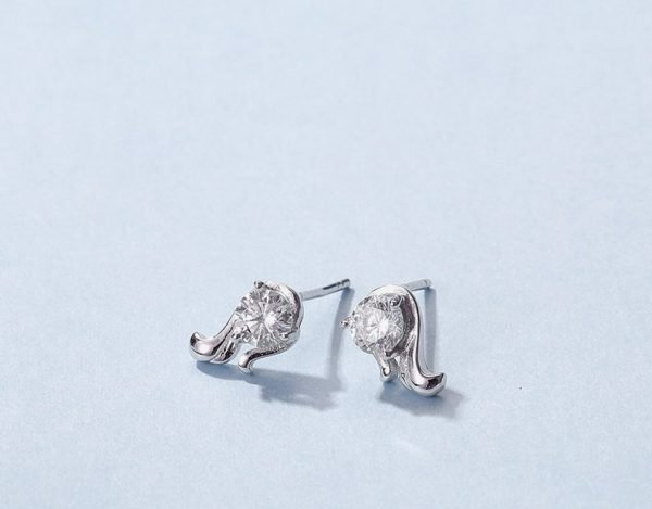 """zodiac silver earrings """"virgo"""" photographed in close-up at an angle"""