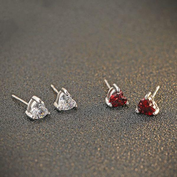 silver earrings in heart shape with cubic zirconia in two colours