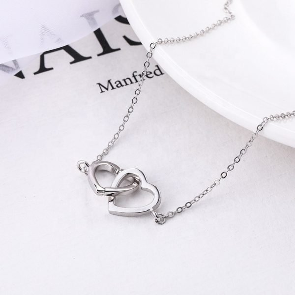 romantic silver necklace with two hearts woven into each other