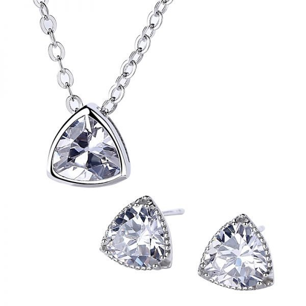 silver set of earrings and necklace in triangular shape and massive cubic zircons on white background
