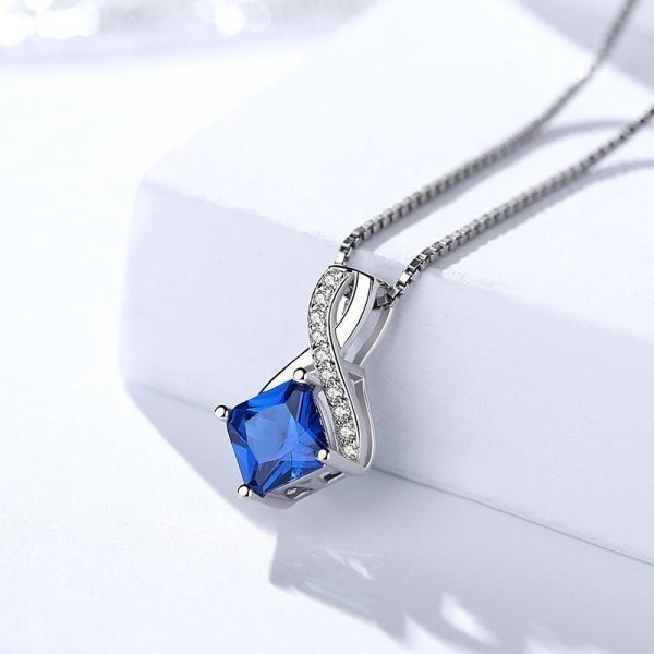 silver necklace with Venetian braid from a set with exquisite blue crystal, complemented by small stones along it