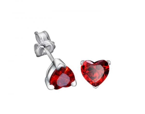 silver earrings in heart shape with red cubic zirconia photographed on white background