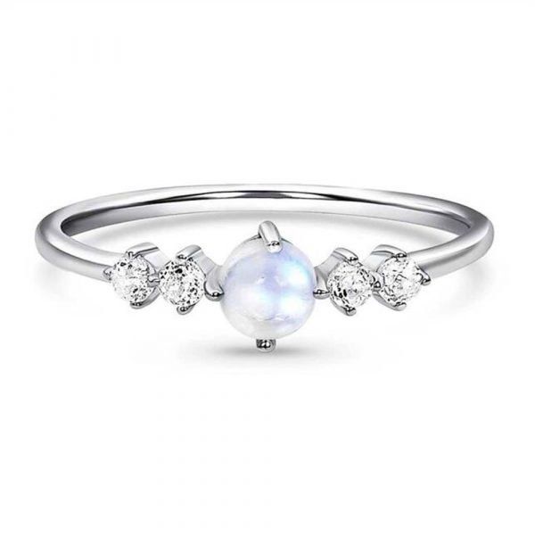 aesthetic silver ring with a natural moonstone in the middle and two small crystals on each side