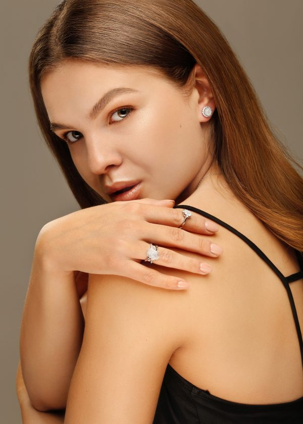 beautiful girl with silver jewelry natural moonstone rings and earrings
