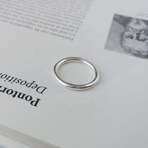 clean silver ring type ring on a book page